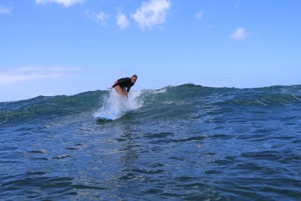 Anna surfing
